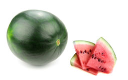 Fresh watermelon and slices Stock Images