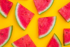 Watermelon slices on yellow background, summer fruit concept royalty free stock photography