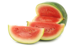 Fresh watermelon and some cut pieces. On a white background Stock Images
