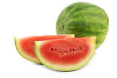 Fresh watermelon and some cut pieces Stock Photos