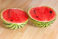 Fresh watermelon on a  wood table Stock Images