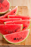 Fresh watermelon on a  wood table Royalty Free Stock Images