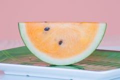 Fresh watermelon yellow on dish. royalty free stock image