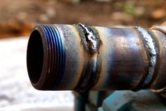 Fresh weld bead on a metal tube macro royalty free stock photography