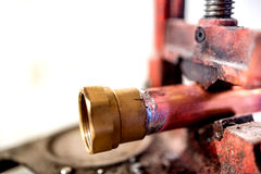 Fresh welding fitting for industrial plumbing on copper pipes Stock Photo