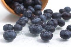Fresh wet Blueberries into a bowl. On white background Stock Photo
