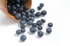 Fresh wet Blueberries into a bowl. On white background Royalty Free Stock Images