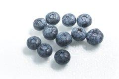 Fresh wet Blueberries. On white background Royalty Free Stock Image