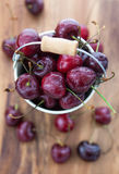 Fresh wet cherries  in a bucket Royalty Free Stock Photos