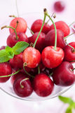 Fresh wet cherry in a glass Royalty Free Stock Photos