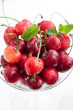 Fresh wet cherry in a glass Stock Photos