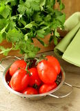 Fresh wet cherry tomatoes and bunch of parsley Stock Photo