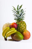 Fresh wet fruits closeup. Group of colorful fresh fruits with water running over it as symbol for healthy nutrition, image taken in front of white background as royalty free stock photo