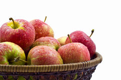 Fresh Wet Red Apples In Basket. Isolated On White Background royalty free stock photography