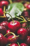 Fresh wet sweet cherries texture, wallpaper and background Stock Photo