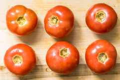 Fresh wet tomato on the board for the background Royalty Free Stock Photo