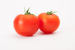 Fresh wet tomato fruits. On white royalty free stock image