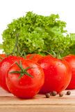 Fresh wet tomatoes, allspice and lettuce Stock Images