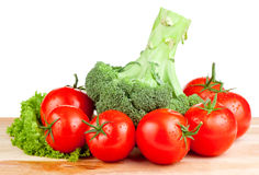 Fresh wet tomatoes, brocolli and lettuce Stock Image