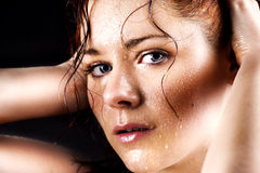 Fresh and wet young woman Stock Photography