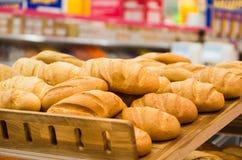 Fresh wheat bread on shelf in supermarket Stock Photos