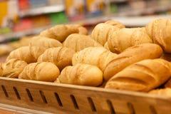 Fresh wheat bread on shelf in supermarket Stock Image