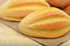 Fresh wheat buns on the sacking background. Stock Photo
