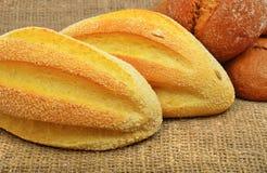 Fresh wheat buns on the sacking background. Stock Photography