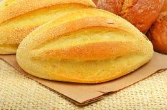 Fresh wheat buns on the sacking background. Royalty Free Stock Image