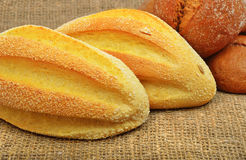 Fresh wheat buns on the sacking background. Royalty Free Stock Images