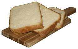 Fresh wheat sliced bread on kichen board Stock Photos