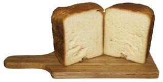 Fresh wheat sliced bread on kichen board Royalty Free Stock Image
