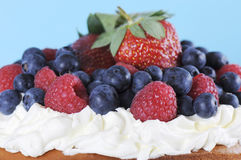 Fresh whipped cream and berries layer cake closeup. Royalty Free Stock Photos