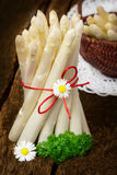 Fresh white asparagus. On old wooden table Stock Images