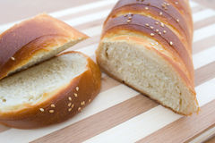 Fresh white bread. Freshly backed bread on the wooden plate Stock Image