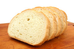 Fresh white bread. On a cutting board Royalty Free Stock Photos