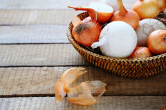 Fresh white and brown onions in a basket Royalty Free Stock Images