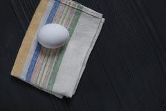 Fresh white eggs on a black wooden background with place for copy space. Fresh white eggs on a black wooden background stock photos