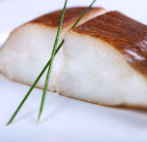Fresh white fish with salad Royalty Free Stock Photography