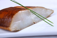 Fresh white fish with salad Royalty Free Stock Images