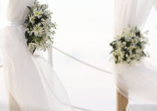 Fresh white flowers as wedding decoration on beach Stock Photos