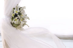 Fresh white flowers as wedding decoration on beach Stock Photography