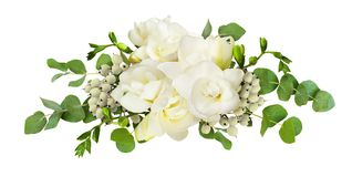 Fresh white freesia flowers and eucalyptus leaves in arrangement stock images