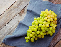 Fresh white grape on old wooden table Royalty Free Stock Photo