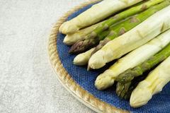 Fresh white and green asparagus on the blue plate. And grey background Stock Photography