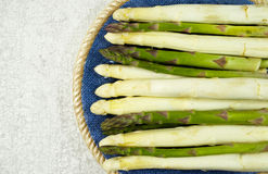 Fresh white and green asparagus on the blue plate. And grey background Stock Images