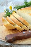 Fresh white loaf of bread with a knife Royalty Free Stock Photography