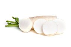 Fresh white radish with slices isolated on white background Stock Photography