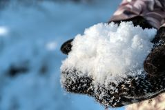 Fresh white snow in knitted stock photo