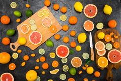 Fresh Whole And Sliced Citrus Fruits On Cutting Boards On Black Royalty Free Stock Photo